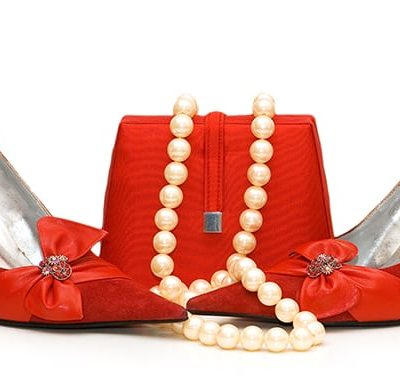 Bold Red stilettos and purse with Pearl Neckless
